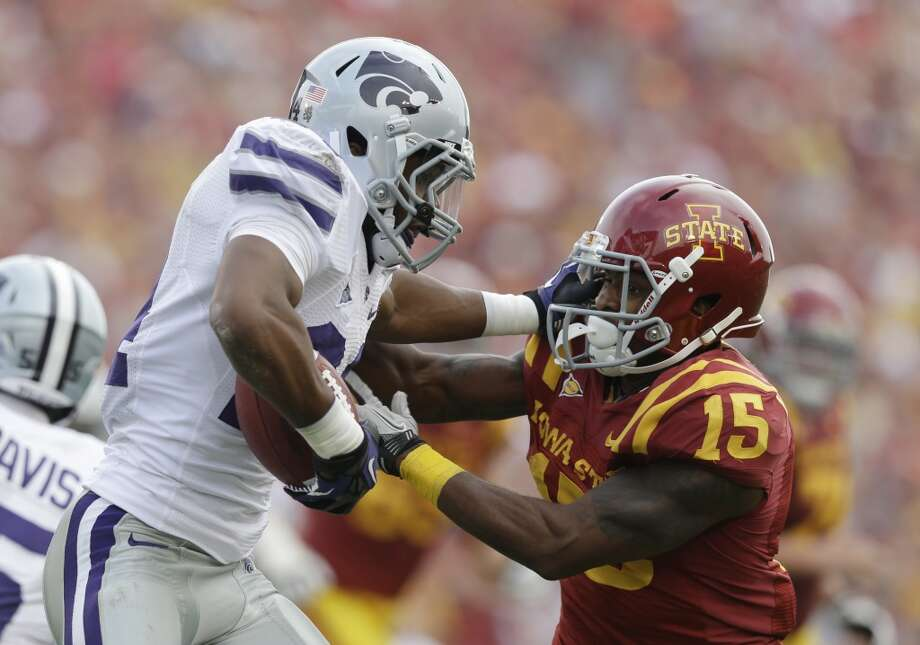 Kansas State defensive back Nigel Malone, left, runs from Iowa State wide receiver Chris Young, right, during the second half of an NCAA college football game, Saturday, Oct. 13, 2012, in Ames, Iowa. Kansas State won 27-21. (AP Photo/Charlie Neibergall) (Associated Press)