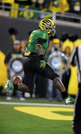 Running back Byron Marshall #9 of the Oregon Ducks leaps up in the air after scoring a touchdown during the third quarter of the game against the Washington Huskies on October 6, 2012 at Autzen Stadium in Eugene, Oregon. Oregon won the game 52-21. (Photo by Steve Dykes/Getty Images) (Getty Images)