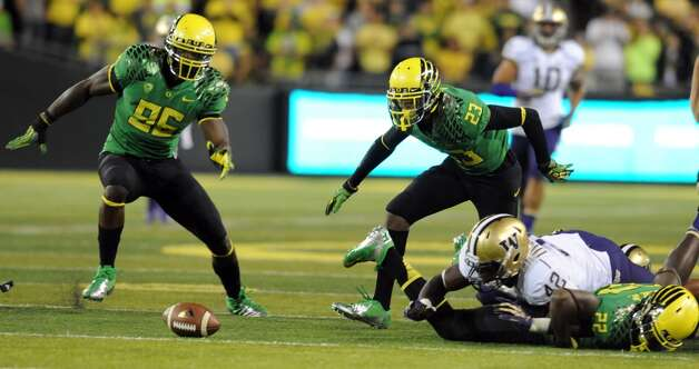 Defensive end Dion Jordan #96 and wide receiver B.J. Kelley #23 of the Oregon Ducks go after a muffed punt by linebacker Cory Littleton #42 of the Washington Huskies during the first quarter of the game on October 6, 2012 at Autzen Stadium in Eugene, Oregon. (Photo by Steve Dykes/Getty Images) (Getty Images)