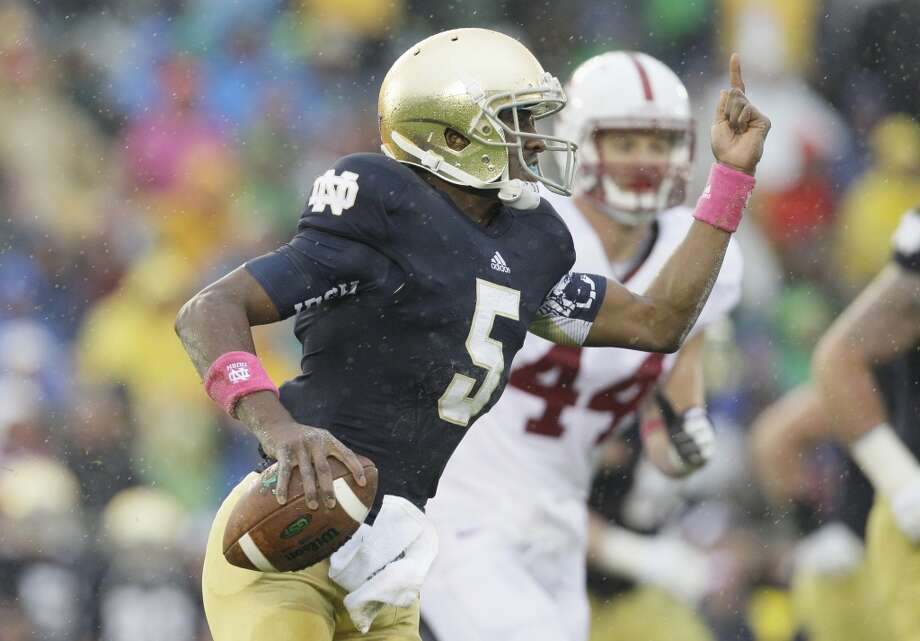 Notre Dame quarterback Everett Golson (5) runs as he looks to a pass during the first half of an NCAA college football game against Stanford in South Bend, Ind., Saturday, Oct. 13, 2012. (AP Photo/Nam Y. Huh) (Associated Press)
