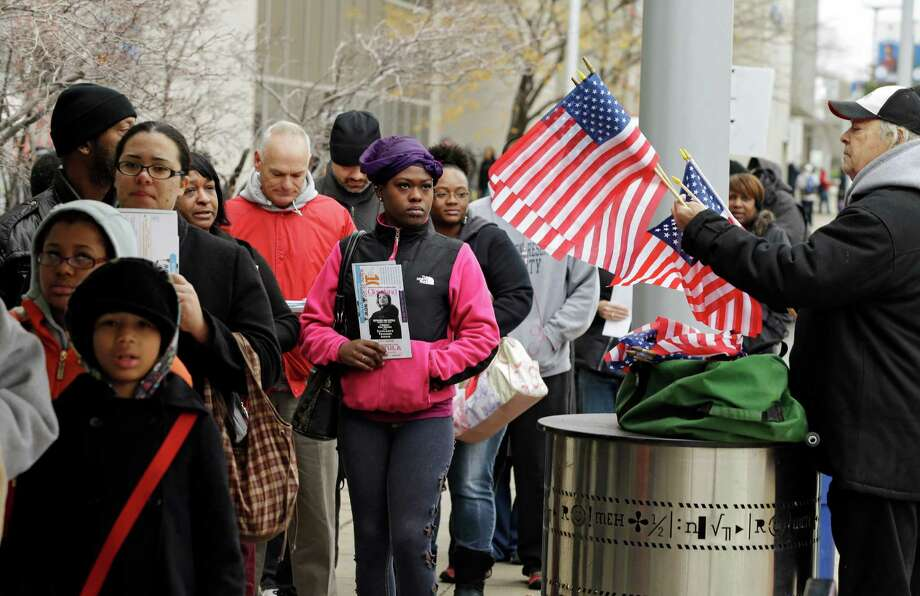 Voters wait in line outside the Cuyahoga County Board of Elections in Cleveland on the final day of early voting Monday, Nov. 5, 2012. About 1.6 million people have voted early in Ohio. (AP Photo/Mark Duncan) Photo: Mark Duncan / AP