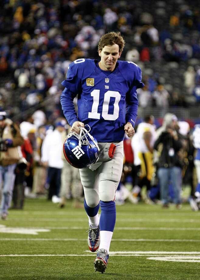 EAST RUTHERFORD, NJ - NOVEMBER 04:  Eli Manning #10 of the New York Giants leaves the field after a loss against the Pittsburgh Steelers during their game at MetLife Stadium on November 4, 2012 in East Rutherford, New Jersey.  (Photo by Jeff Zelevansky/Getty Images) Photo: Jeff Zelevansky