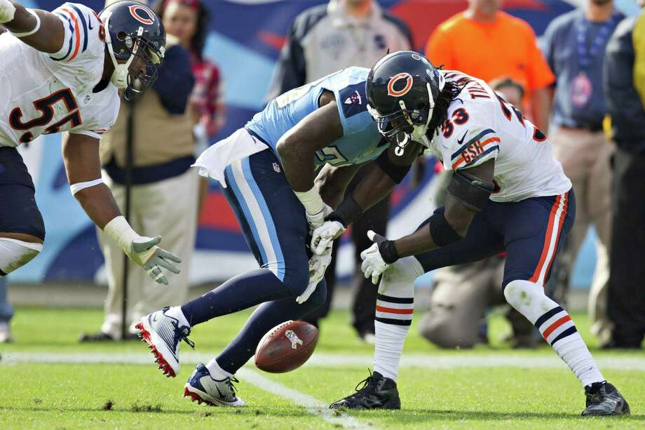 NASHVILLE, TN - NOVEMBER 4:  Chris Johnson #28 of the Tennessee Titans fumbles the ball after being hit by Charles Tillman #33 of the Chicago Bears at LP Field on November 4, 2012 in Nashville, Tennessee.  (Photo by Wesley Hitt/Getty Images) Photo: Wesley Hitt, Stringer / 2012 Getty Images