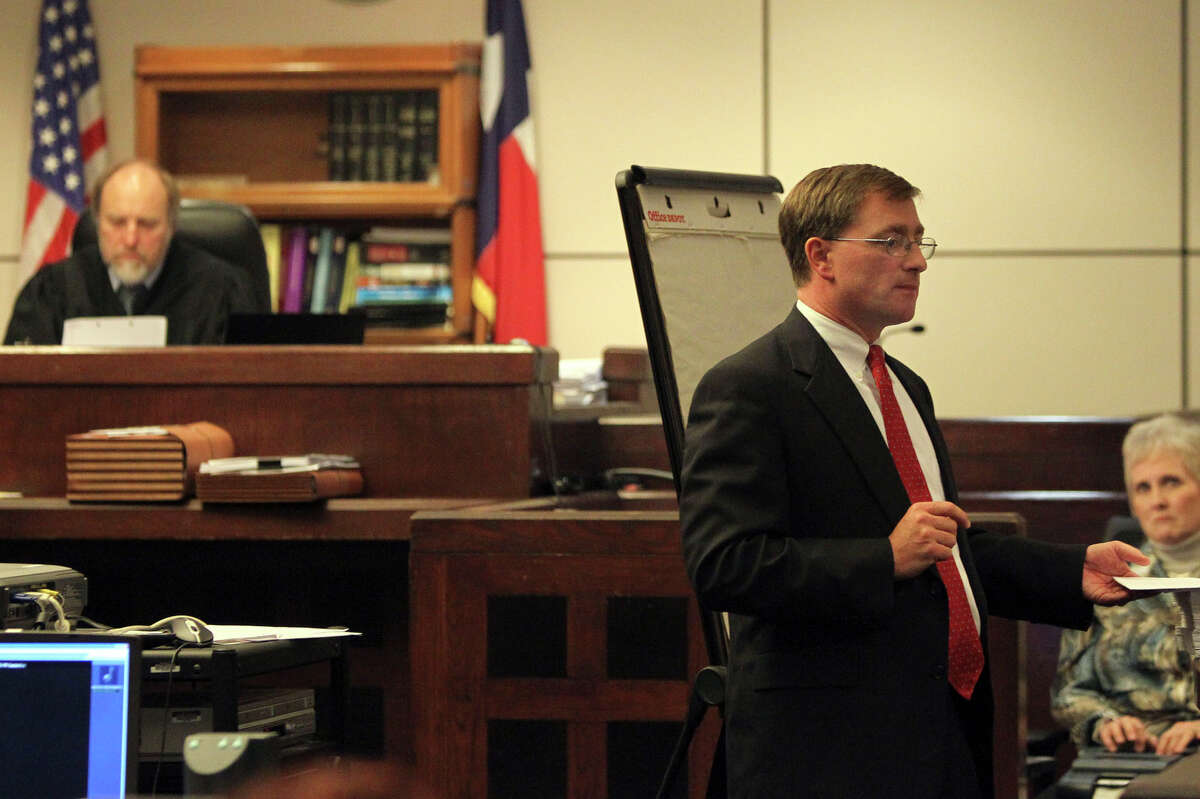 Prosecuting attorney Charles Rich (right) makes final arguments to the jury Monday November 29, 2010 during the manslaughter and aggravated assault trial of former San Antonio Police officer David Seaton in the 226th District Court. On the left is Judge Sid Harle. JOHN DAVENPORT/jdavenport@express-news.net