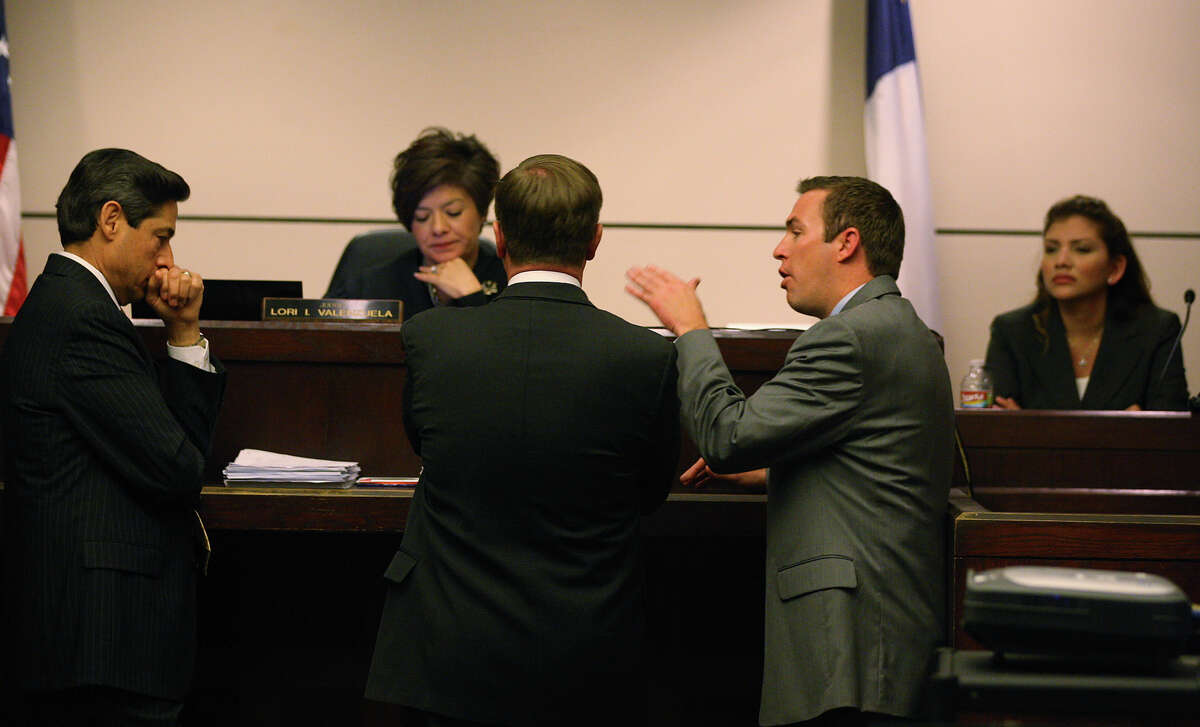 Prosecutor Clayton Haden, center in gray, argues a point in the 437th District Court, Monday, Feb. 13, 2012. From left, are defense attorney Roy Barrera, Jr., Judge Lori I. Valenzuela and prosecutor Charles Rich. JERRY LARA/glara@express-news.net