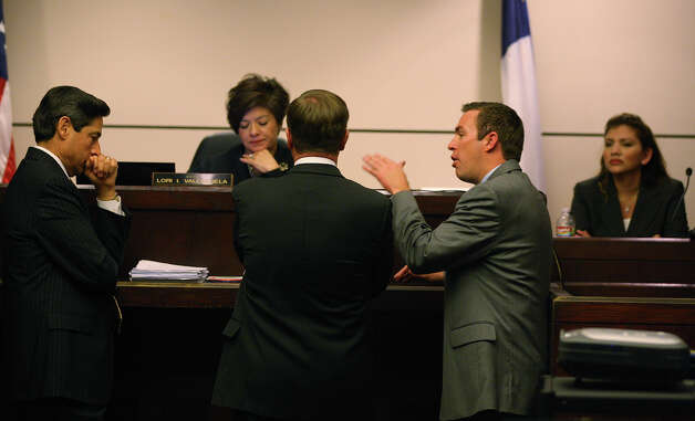 Prosecutor Clayton Haden, center in gray, argues a point in the 437th District Court, Monday, Feb. 13, 2012. From left, are defense attorney Roy Barrera, Jr., Judge Lori I. Valenzuela and prosecutor Charles Rich. JERRY LARA/glara@express-news.net Photo: Jerry Lara, Express-News / © 2012 San Antonio Express-News