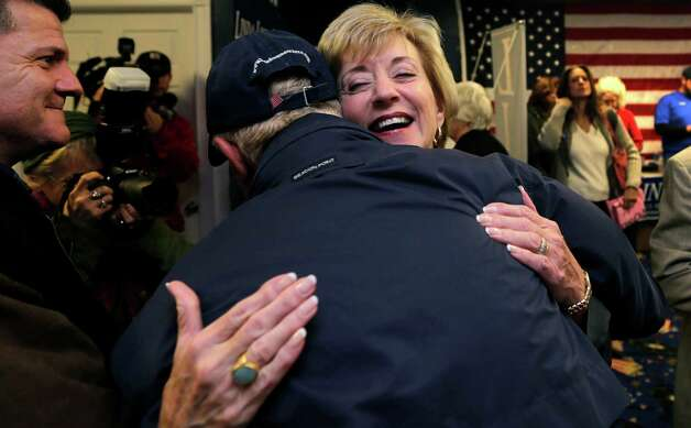 Republican candidate for U.S. Senate Linda McMahon embraces volunteer Bruce Farmer, of Clinton, Conn., while visiting a campaign office in East Lyme, Conn., Monday, Nov. 5, 2012. McMahon and Democratic opponent Chris Murphy are vying for the Senate seat now held by Joe Lieberman, an independent who's retiring. (AP Photo/Charles Krupa) Photo: Charles Krupa, Associated Press / AP