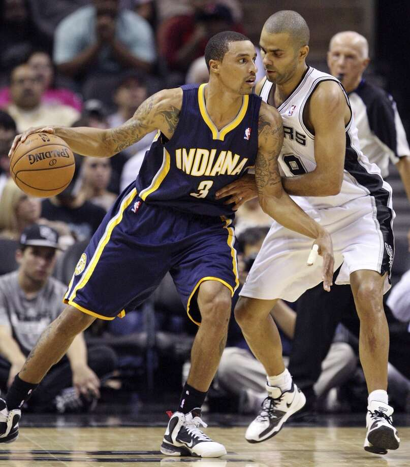 San Antonio Spurs' Tony Parker defends Indiana Pacers' George Hill during first half action Monday Nov. 5, 2012 at the AT&T Center. (Edward A. Ornelas / San Antonio Express-News)