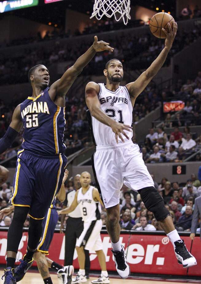 San Antonio Spurs' Tim Duncan shoots around Indiana Pacers' Roy Hibbert during first half action Monday Nov. 5, 2012 at the AT&T Center. (Edward A. Ornelas / San Antonio Express-News)