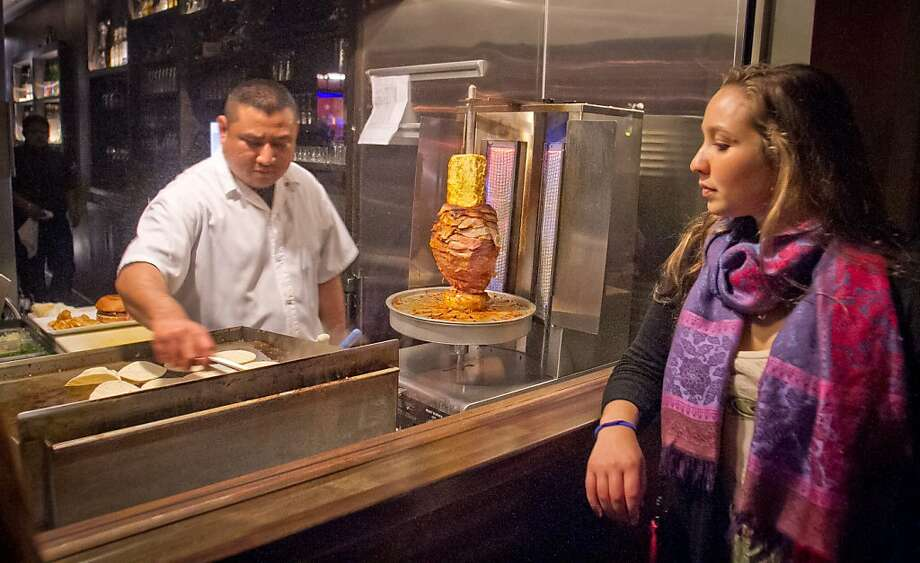 A customer watches Freddy Balam make tacos at Mosto Tequila bar on Valencia Street in San Francisco. Photo: John Storey, Special To The Chronicle