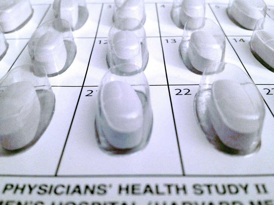 This Oct. 11, 2012 file photo provided by the Brigham and Women's Hospital shows a monthly calendar vitamin pack used in a long-term study on multivitamins. Multivitamins might help lower the risk for cancer in healthy older men but do not affect their chances of developing heart disease, new research suggests. (AP Photo/Brigham and Women's Hospital, File) Photo: Uncredited