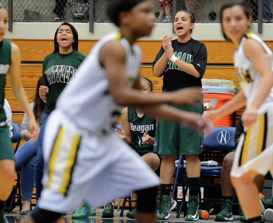Reagan players cheer on their teammates from the bench during a girls non-district basketball game between the Brennan Bears and the Reagan Rattlers at Paul Taylor Field House in San Antonio, Saturday, November 5, 2012.