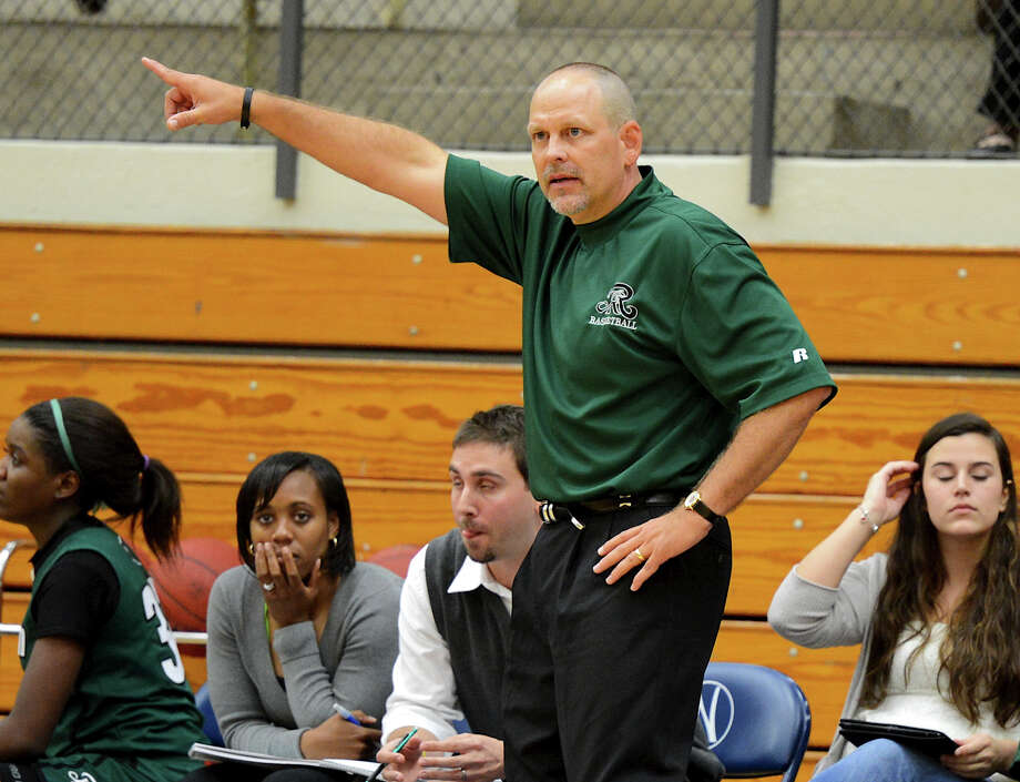 Reagan head coach Terry Barton directs his players during a girls non-district basketball game between the Brennan Bears and the Reagan Rattlers at Paul Taylor Field House in San Antonio, Saturday, November 5, 2012.