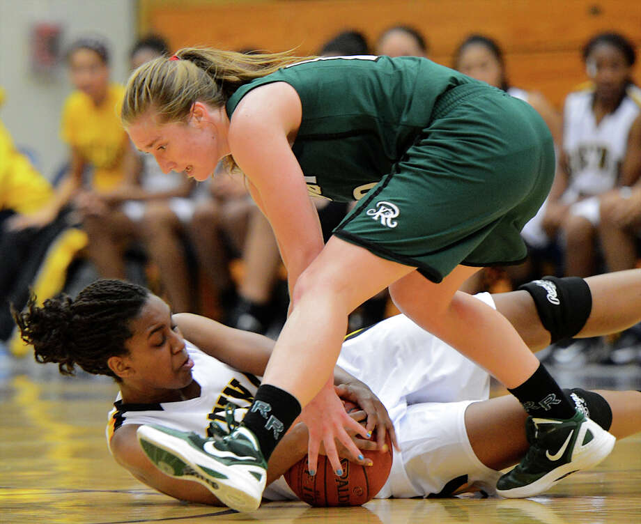 Reagan's Wendy Knight (10) and Brennan's Tanaeya Boclair (32) battle for control of the ball near mid-court during a girls non-district basketball game between the Brennan Bears and the Reagan Rattlers at Paul Taylor Field House in San Antonio, Saturday, November 5, 2012.