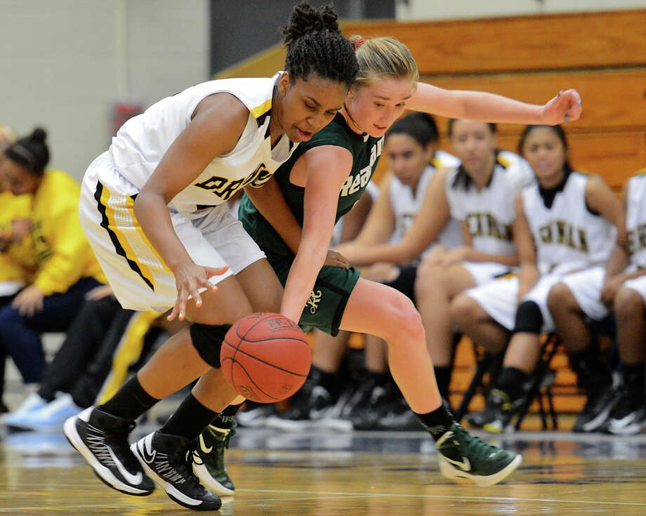 Reagan's Wendy Knight (10) tries to steel the ball from Brennan's Tanaeya Boclair (32) during a girls non-district basketball game between the Brennan Bears and the Reagan Rattlers at Paul Taylor Field House in San Antonio, Saturday, November 5, 2012. John Albright / Special to the Express-News. Photo: JOHN ALBRIGHT, Express-News / San Antonio Express-News