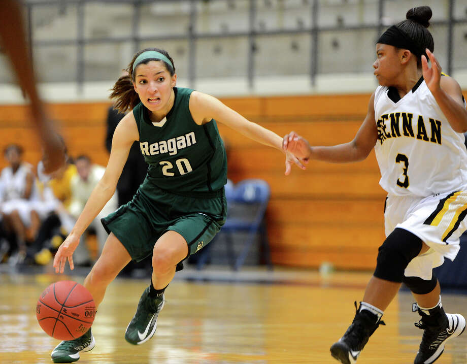 Reagan's Tessa Ramirez (20) tries to dribble past Brennan's Ashlynn Graham (3) during a girls non-district basketball game between the Brennan Bears and the Reagan Rattlers at Paul Taylor Field House in San Antonio, Saturday, November 5, 2012.