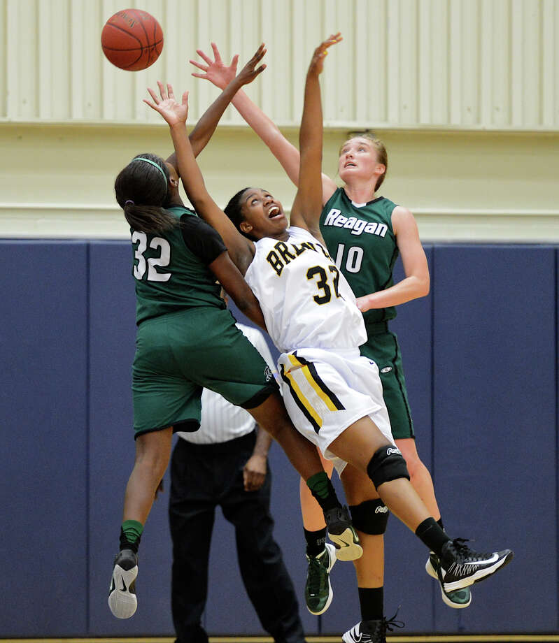 Reagan's Moriah Mack (32) and Wendy Knight (10) battle Brennan's Tanaeya Boclair (32) for a rebound during a girls non-district basketball game between the Brennan Bears and the Reagan Rattlers at Paul Taylor Field House in San Antonio, Saturday, November 5, 2012. John Albright / Special to the Express-News. Photo: JOHN ALBRIGHT, Express-News / San Antonio Express-News