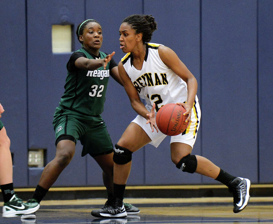 Tanaeya Boclair (right) averaged 16 points and 11 rebounds while leading Brennan to the Class 4A state tournament. Photo: John Albright, For The San Antonio Express-News / San Antonio Express-News