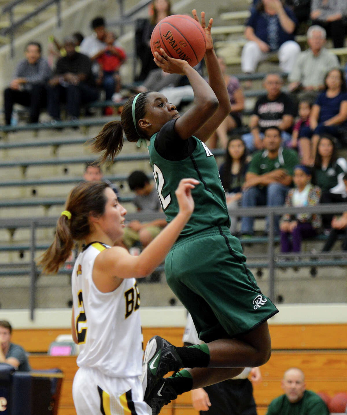 Reagan's Moriah Mack (32) takes a shot during a girls non-district basketball game between the Brennan Bears and the Reagan Rattlers at Paul Taylor Field House in San Antonio, Saturday, November 5, 2012. John Albright / Special to the Express-News.