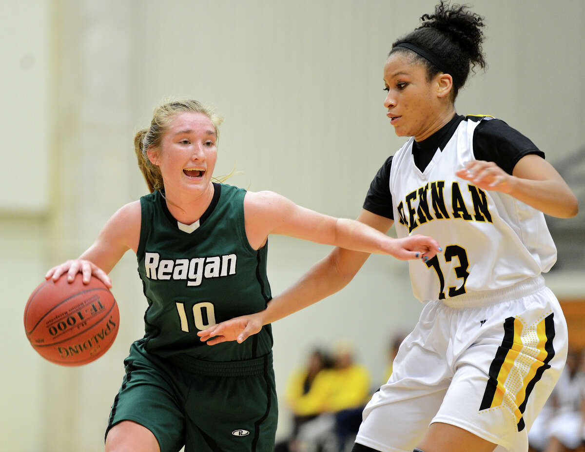 Reagan's Wendy Knight (10) tries to dribble past Brennan's Kiara Etheridge (13) during a girls non-district basketball game between the Brennan Bears and the Reagan Rattlers at Paul Taylor Field House in San Antonio, Saturday, November 5, 2012. John Albright / Special to the Express-News.