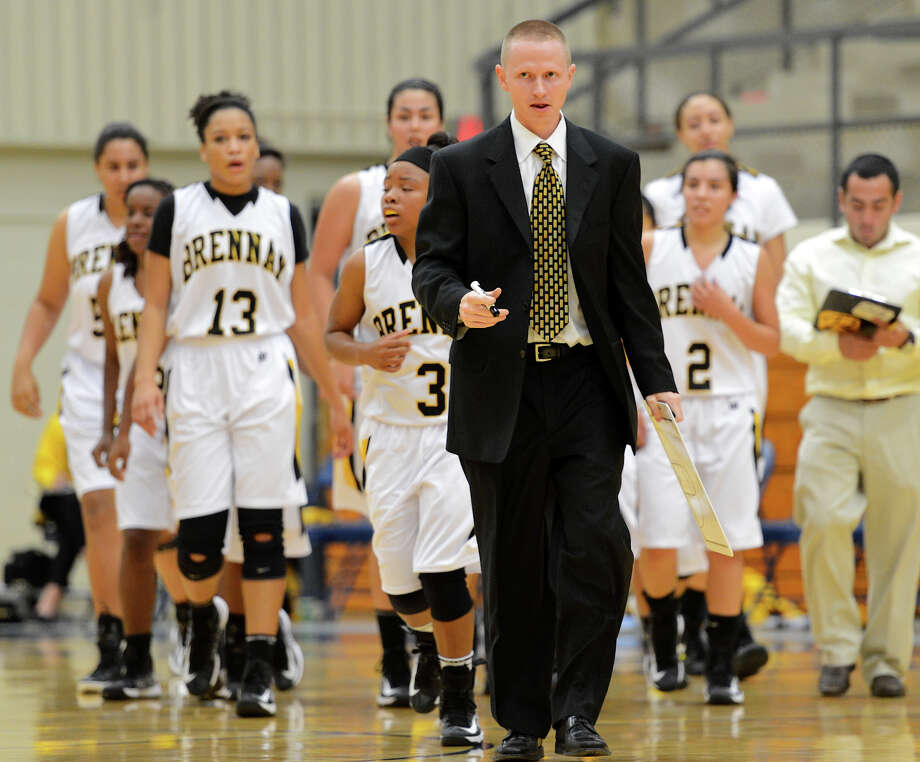 Brennan new head coach Koty Cowgill leads his team off the court at halftime during a girls non-district basketball game between the Brennan Bears and the Reagan Rattlers at Paul Taylor Field House in San Antonio, Saturday, November 5, 2012.