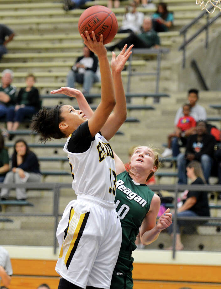 Brennan's Kiara Etheridge (13) takes a shot over Reagan's Wendy Knight (10) during a girls non-district basketball game between the Brennan Bears and the Reagan Rattlers at Paul Taylor Field House in San Antonio, Saturday, November 5, 2012.