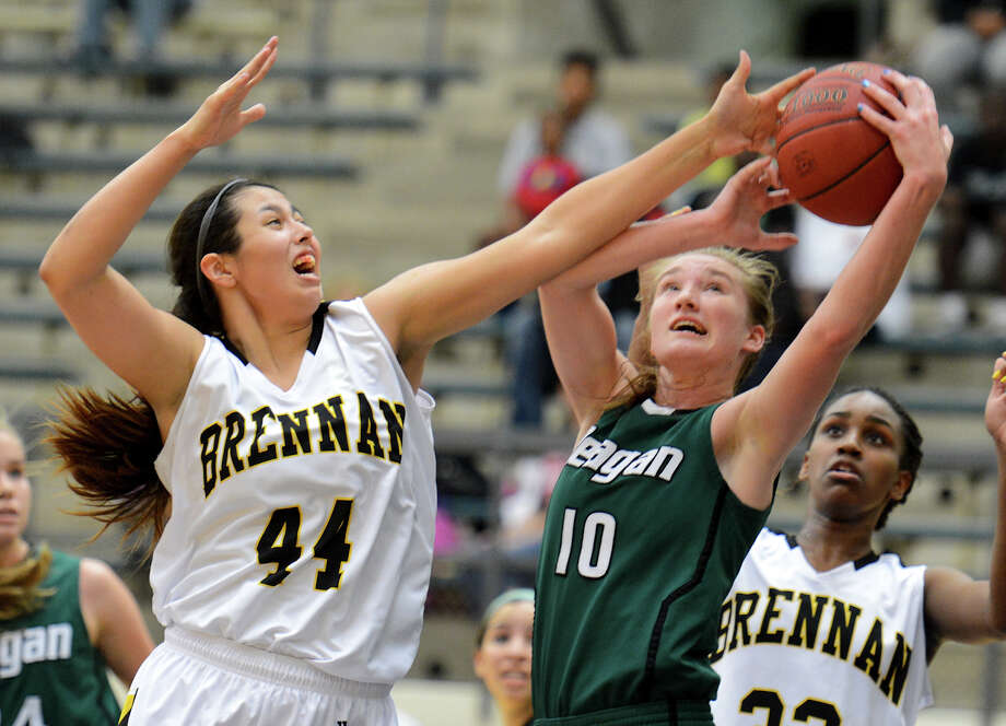 Reagan's Wendy Knight (10) and Brennan's Eliza Martinez (44) battle for a rebound during a girls non-district basketball game between the Brennan Bears and the Reagan Rattlers at Paul Taylor Field House in San Antonio, Saturday, November 5, 2012.