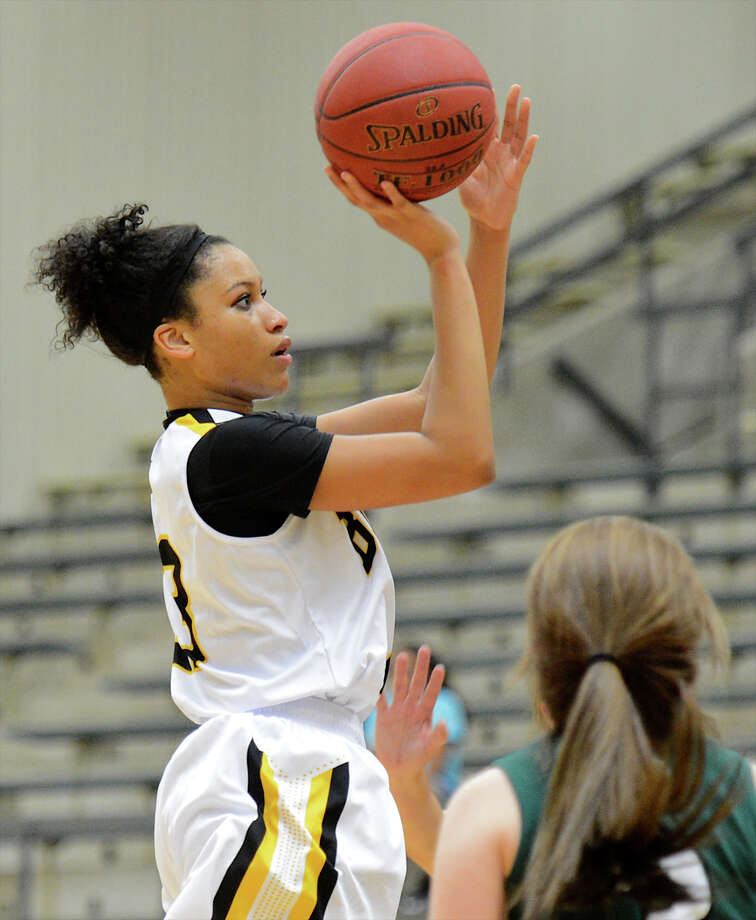 Brennan's Kiara Etheridge (13) takes a shot during a girls non-district basketball game between the Brennan Bears and the Reagan Rattlers at Paul Taylor Field House in San Antonio, Saturday, November 5, 2012. John Albright / Special to the Express-News. Photo: JOHN ALBRIGHT, Express-News / San Antonio Express-News