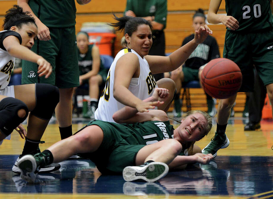 Reagan's Wendy Knight (10) and Brennan's Tia Mason (50) watch as a ball gets away from them during a girls non-district basketball game between the Brennan Bears and the Reagan Rattlers at Paul Taylor Field House in San Antonio, Saturday, November 5, 2012. John Albright / Special to the Express-News. Photo: JOHN ALBRIGHT, Express-News / San Antonio Express-News