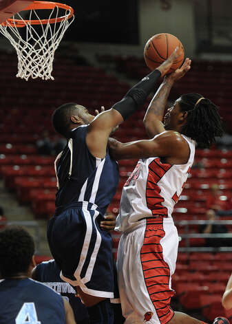 Lamar's Amos Wilson shoots against Northwood at the Montagne Monday night. Photo taken Monday, November 5, 2012 Guiseppe Barranco/The Enterprise Photo: Guiseppe Barranco, STAFF PHOTOGRAPHER / The Beaumont Enterprise