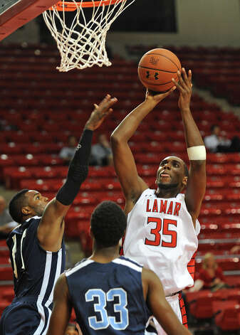 Lamar's Stan Brown shoots against Northwood at the Montagne Monday night. Photo taken Monday, November 5, 2012 Guiseppe Barranco/The Enterprise Photo: Guiseppe Barranco, STAFF PHOTOGRAPHER / The Beaumont Enterprise