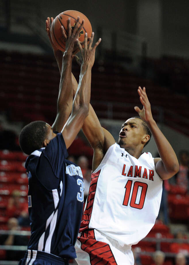 Lamar's Rhon Mitchell shoots against Northwood at the Montagne Monday night. Photo taken Monday, November 5, 2012 Guiseppe Barranco/The Enterprise Photo: Guiseppe Barranco, STAFF PHOTOGRAPHER / The Beaumont Enterprise