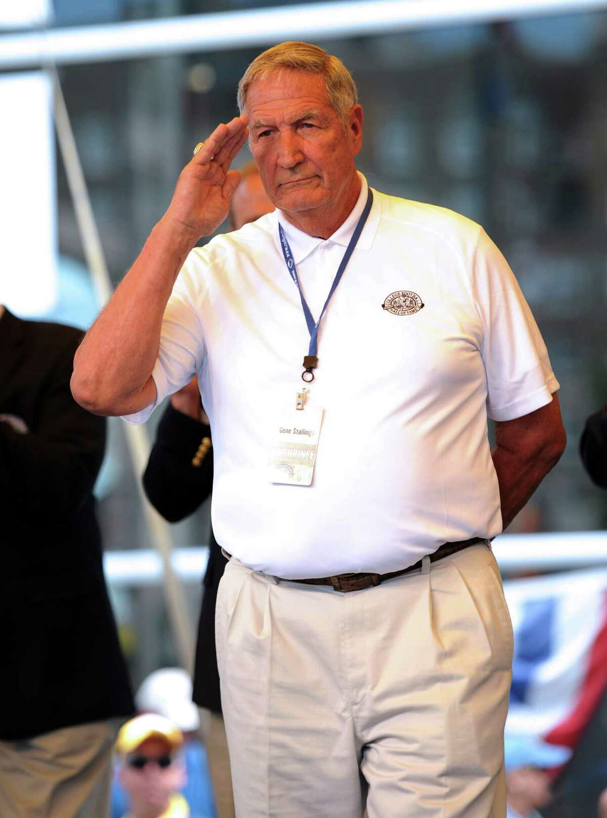 Coach Gene Stallings, Texas A&M 1965-71 and Alabama 1990-96, salutes the crowd prior to receiving his blazer during the College Football Hall of Fame Enshrinement Festival in South Bend, Ind., on Saturday, July 16, 2011. (AP Photo/Joe Raymond)