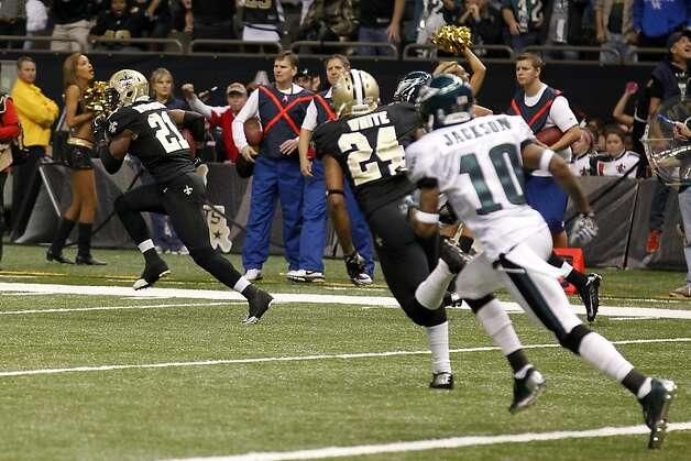 Saints cornerback patrick robinson 21 returns an interception of a