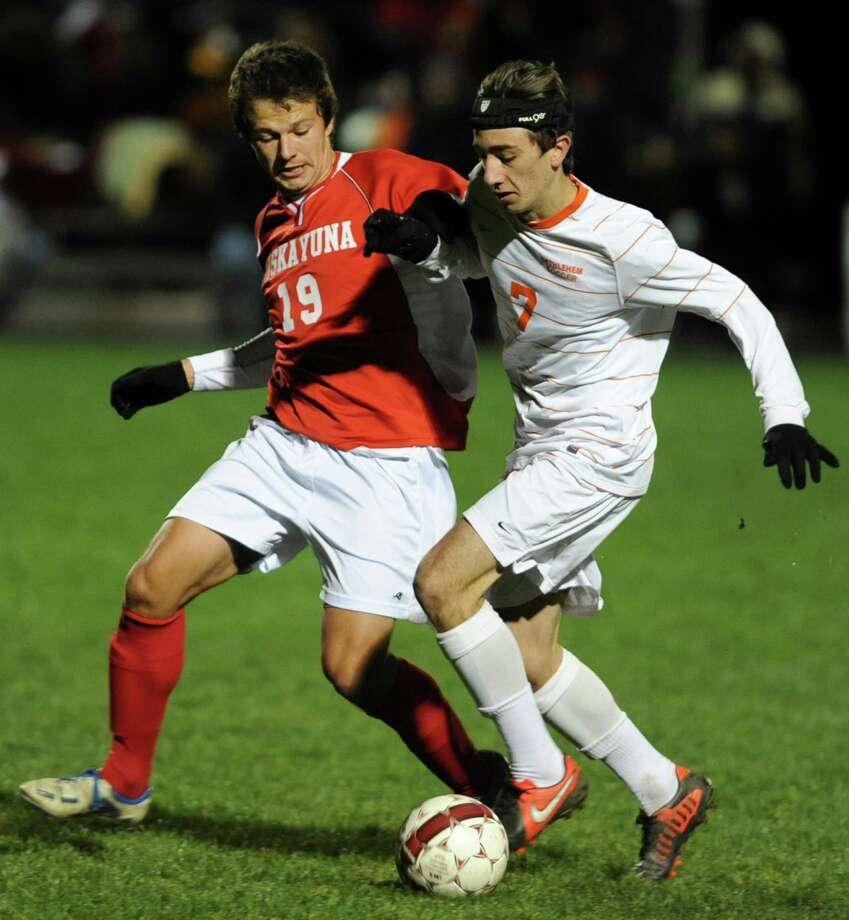 From left, Niskayuna's Phillip Weeber battles for the ball with Bethehem's Austin Lang during the Class AA boy's soccer sectional final  on Monday Nov. 5, 2012 in Colonie, N.Y.  (Lori Van Buren / Times Union) Photo: Lori Van Buren