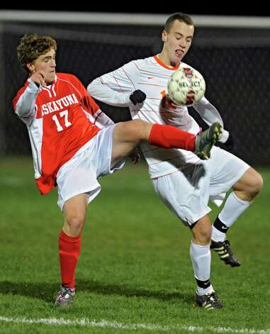From left, Niskayuna's Christian Koudal battles for the ball with Bethehem's Andrew Carroll during the Class AA boy's soccer sectional final  on Monday Nov. 5, 2012 in Colonie, N.Y.  (Lori Van Buren / Times Union) Photo: Lori Van Buren