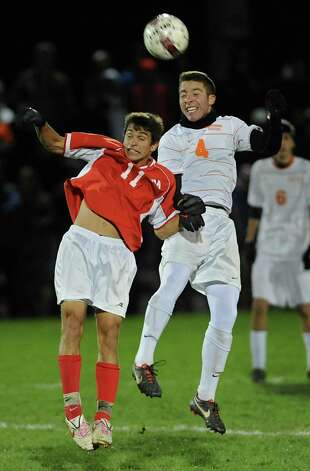 From left, Niskayuna's Joe Repicky battles to head the ball with Bethehem's Elliot Hiller during the Class AA boy's soccer sectional final  on Monday Nov. 5, 2012 in Colonie, N.Y.  (Lori Van Buren / Times Union) Photo: Lori Van Buren
