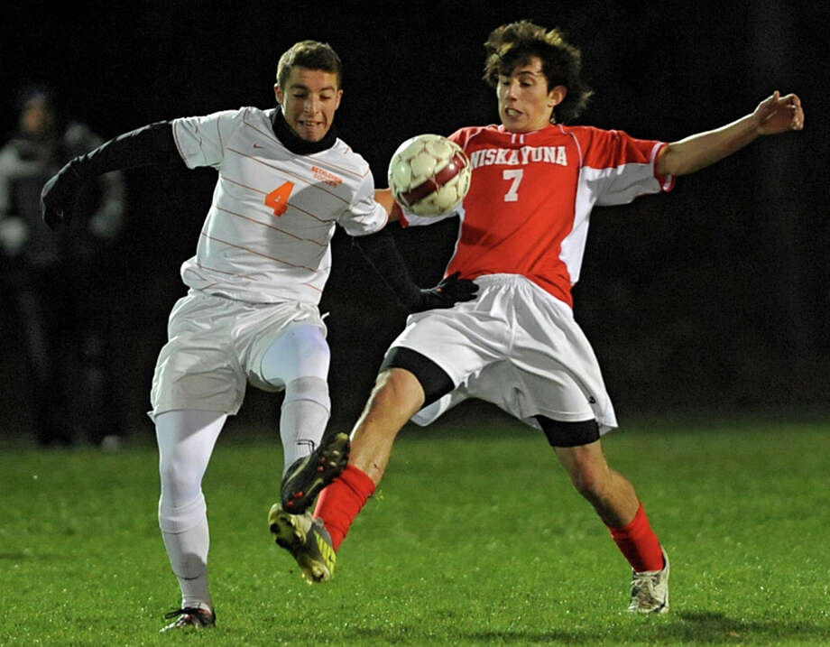 From left, Bethehem's Elliot Hiller battles for the ball with Niskayuna's Jacques Fair during the Class AA boy's soccer sectional final  on Monday Nov. 5, 2012 in Colonie, N.Y.  (Lori Van Buren / Times Union) Photo: Lori Van Buren
