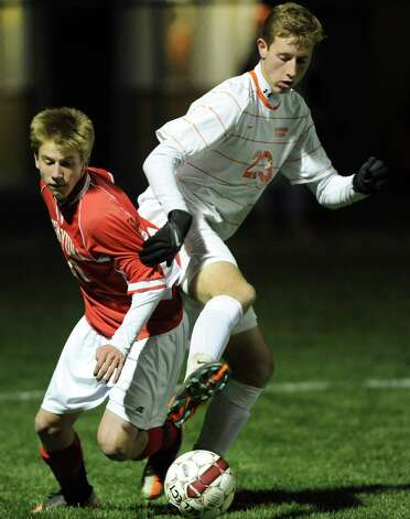 From left, Niskayuna's Kevin Crisey battles for the ball with Bethehem's Liam Roohan during the Class AA boy's soccer sectional final  on Monday Nov. 5, 2012 in Colonie, N.Y.  (Lori Van Buren / Times Union) Photo: Lori Van Buren