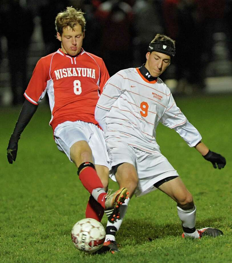 From left, Niskayuna's Ian Cutting battles for the ball with Bethehem's Ethan Strauss during the Class AA boy's soccer sectional final  on Monday Nov. 5, 2012 in Colonie, N.Y.  (Lori Van Buren / Times Union) Photo: Lori Van Buren