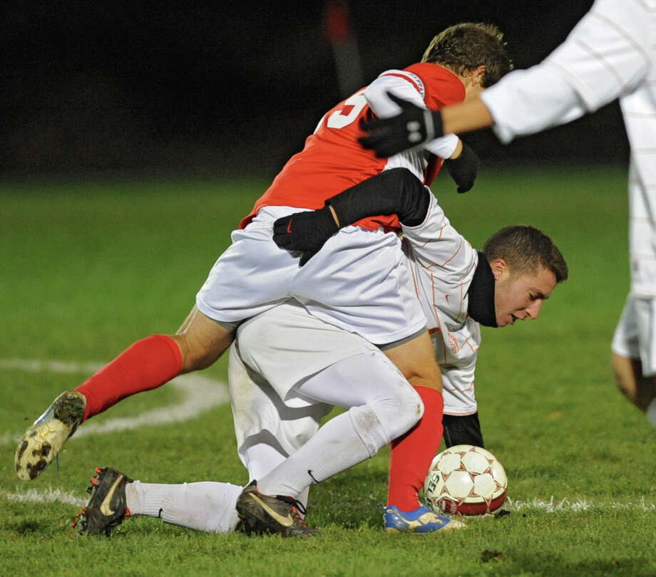 From left, Niskayuna's Phillip Weeber gets tangled up with Bethehem's Elliot Hiller as they battle for the ball during the Class AA boy's soccer sectional final  on Monday Nov. 5, 2012 in Colonie, N.Y.  (Lori Van Buren / Times Union) Photo: Lori Van Buren