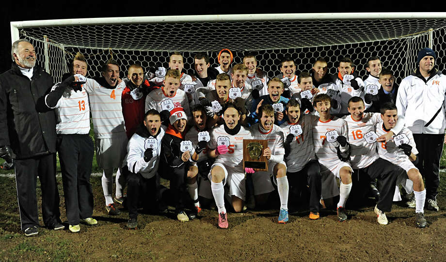The Bethlehem team poses for a team photo with their awards after defeating Niskayuna in the Class AA boy's soccer sectional final on Monday Nov. 5, 2012 in Colonie, N.Y.  (Lori Van Buren / Times Union) Photo: Lori Van Buren