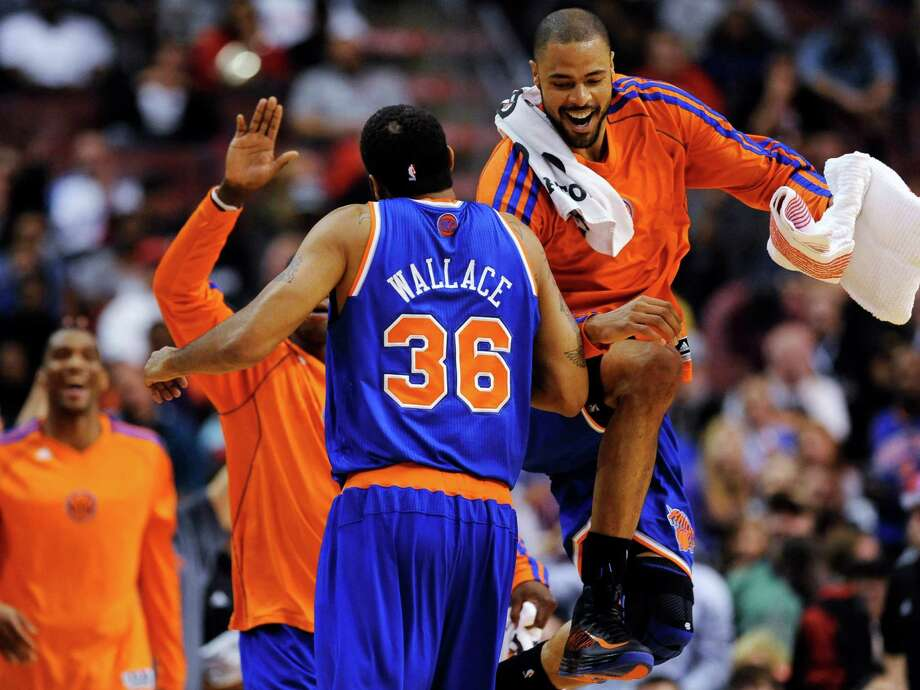 New York Knicks' Rasheed Wallace (36) celebrates with Tyson Chandler, right, at the end of the third quarter of an NBA basketball game against the Philadelphia 76ers on Monday, Nov. 5, 2012, in Philadelphia. The Knicks won 110-88. (AP Photo/Michael Perez) Photo: Michael Perez