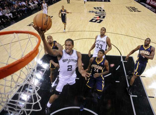 San Antonio Spurs' Kawhi Leonard shoots between Indiana Pacers' David West (left) and Paul George during second half action Monday Nov. 5, 2012 at the AT&T Center. The Spurs won 101-79. (Edward A. Ornelas / San Antonio Express-News)