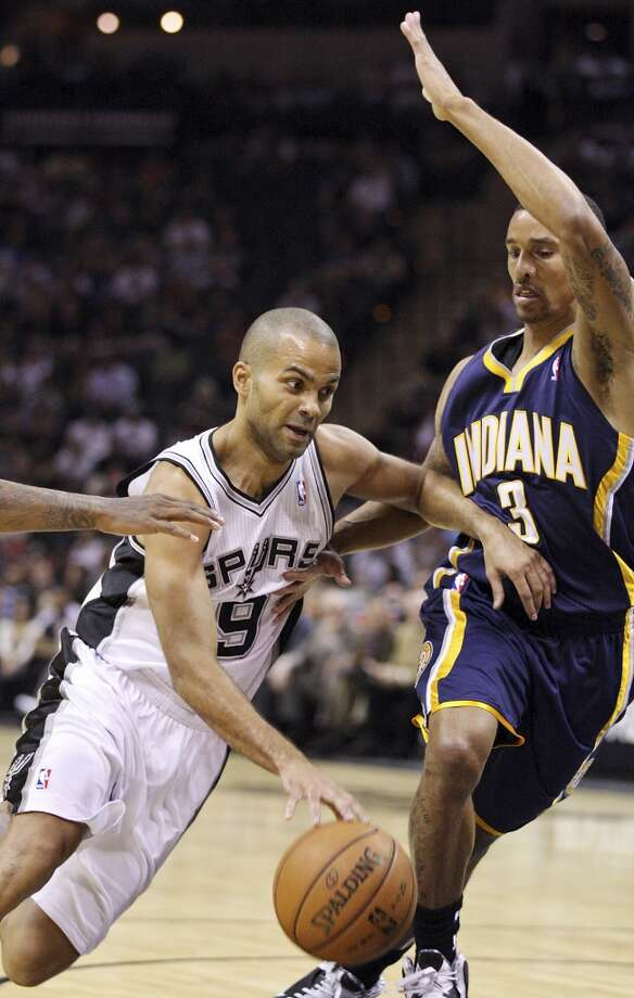 San Antonio Spurs' Tony Parker drives around Indiana Pacers' George Hill during first half action Monday Nov. 5, 2012 at the AT&T Center. (Edward A. Ornelas / San Antonio Express-News)