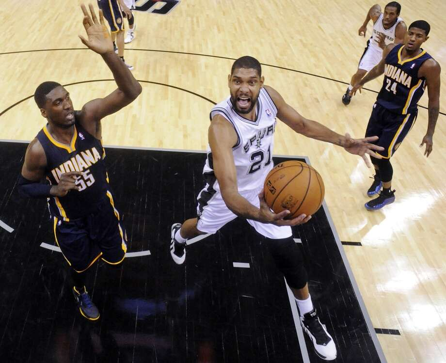 San Antonio Spurs' Tim Duncan drives to the basket around Indiana Pacers' Roy Hibbert during second half action Monday Nov. 5, 2012 at the AT&T Center. The Spurs won 101-79. (Edward A. Ornelas / San Antonio Express-News)