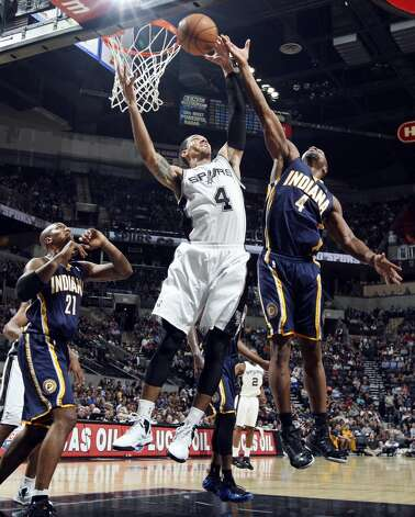San Antonio Spurs' Danny Green grabs for a rebound between Indiana Pacers' David West (left) and Sam Young during second half action Monday Nov. 5, 2012 at the AT&T Center. The Spurs won 101-79. (Edward A. Ornelas / San Antonio Express-News)