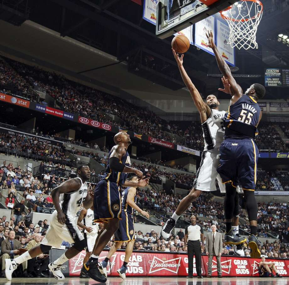 San Antonio Spurs' Tim Duncan shoots around Indiana Pacers' Roy Hibbert during second half action Monday Nov. 5, 2012 at the AT&T Center. The Spurs won 101-79. (Edward A. Ornelas / San Antonio Express-News)