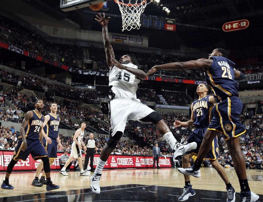 San Antonio Spurs' DeJuan Blair shoots between Indiana Pacers defenders during second half action Monday Nov. 5, 2012 at the AT&T Center. The Spurs won 101-79. (Edward A. Ornelas / San Antonio Express-News)