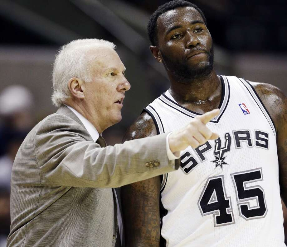 San Antonio Spurs head coach Gregg Popovich, left, talks with DeJuan Blair (45) during the first quarter of an NBA basketball game against the Indiana Pacers, Monday, Nov. 5, 2012, in San Antonio. (AP Photo/Eric Gay) (Associated Press)